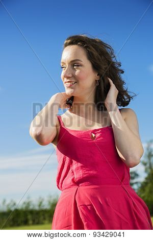 Young Lady On A Blue Sky Background
