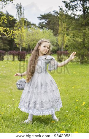 Girl Pretending Princess Almost Blown Away