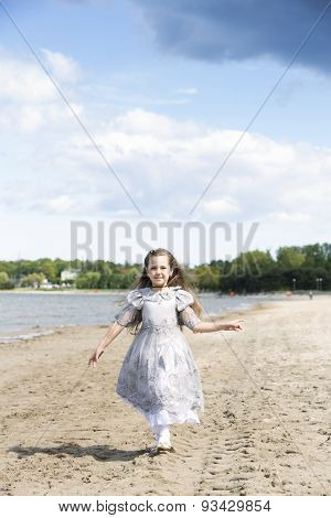 The Little Child Runs Towards The Wind