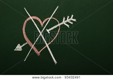 crossed heart on chalkboard