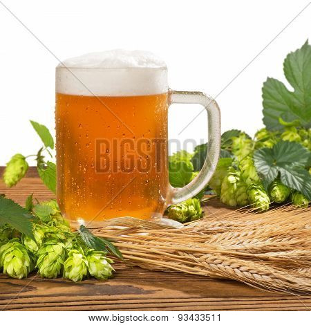 Glass Of Unfiltered Beer With Hops And Barley