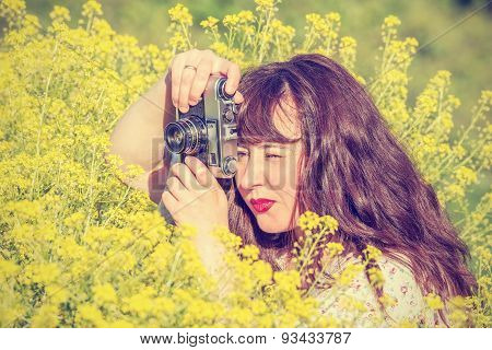 Woman Shooting Flowers On The Meadow.
