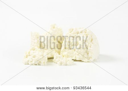slices of fresh curd cheese on white background