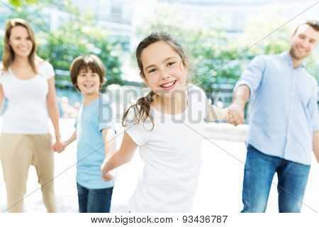Girl with her family in the background
