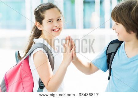 Girl and boy with backpacks