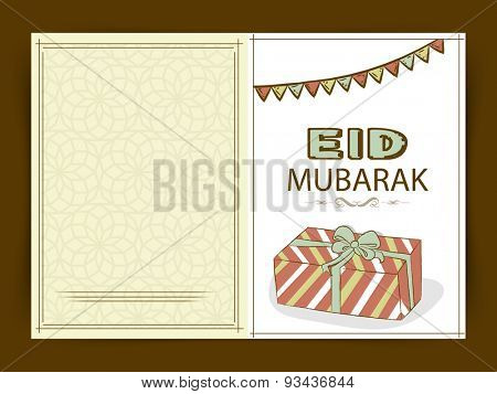 Muslim community festival, Eid Mubarak celebration greeting card with colorful bunting and gift.
