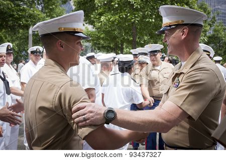 NEW YORK - MAY 22 2015: A US Marine Corpsman is congratulated by a senior officer after the promotion ceremony at the National September 11 Memorial site during Fleet Week 2015.