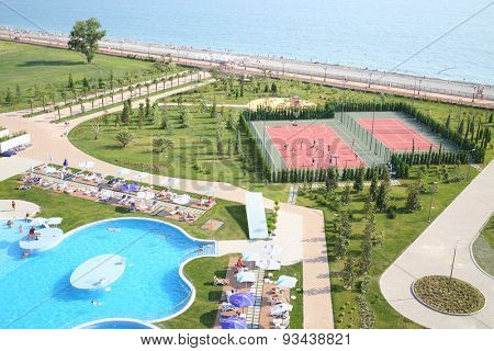 SOCHI, RUSSIA - JUL 26, 2014: Territory of the Hotel Radisson Blu Paradise Resort and Spa with swimming pool, playground and beach