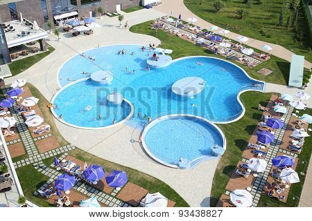 SOCHI, RUSSIA - JUL 26, 2014: Large swimming pool with tourists on site Hotel Radisson Blu Paradise Resort and Spa