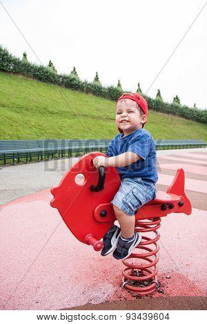 Child On Playground Spring