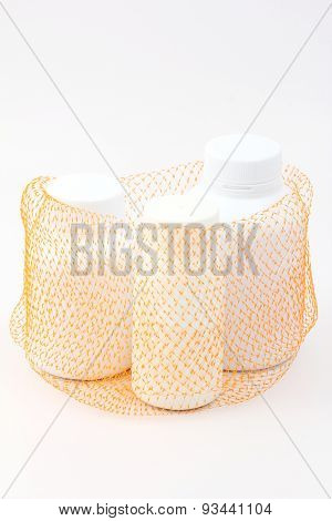 Net  Bag Container Group Of White Medicine Bottle