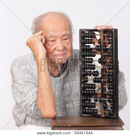 Old Man Use Chinese Abacus