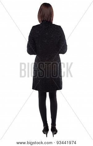 Photo of young woman in fur coat from back