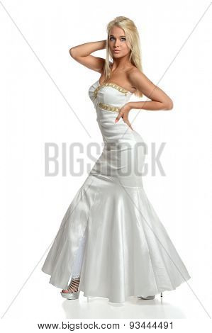 Portrait of beautiful teen girl dressed in elegant evening gown isolated over white background