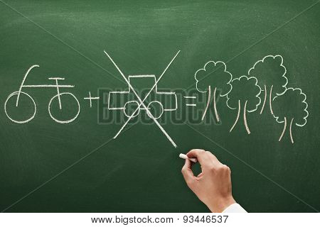 man sketching on blackboard a concept of environment conservation bicycle or car
