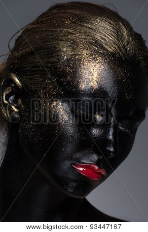 Portrait of pretty girl with creative makeup with black skintone and golden dust on her hair