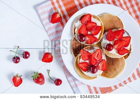 Pancakes traditional homemade American breakfast or lunch pastry dessert with butter and fruits on w