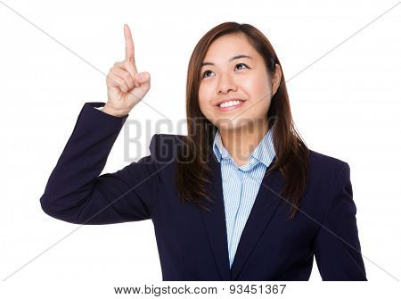 Asian businesswoman touch the imaginary panel