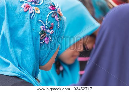 Muslim Young Ladies Wearing Bright Turquoise Hijab