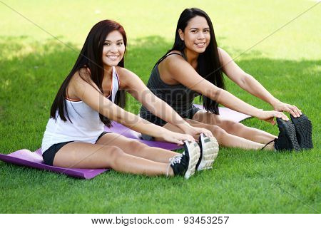 Group of people doing a boot camp workout outside