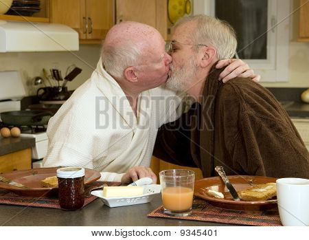 mature gay couple kissing