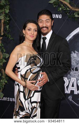 LOS ANGELES - JUN 9:  Mirelly Taylor, Brian Tee at the
