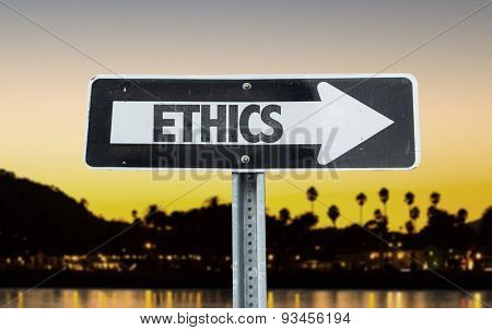 Ethics direction sign with sunset background