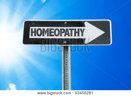 Homeopathy direction sign with a beautiful day
