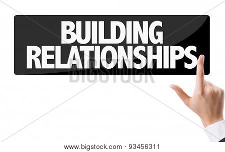 Businessman pressing button with the text: Building Relationships