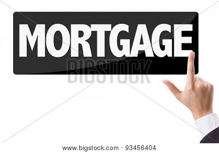 Businessman pressing button with the text: Mortgage