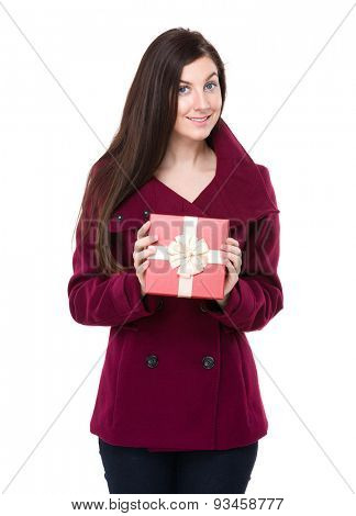 Brunette woman showing with present box