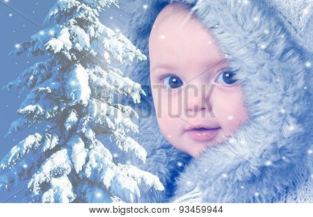 Baby girl wearing a winter fur coat, with a snow covered Christmas tree. Double exposure effect.