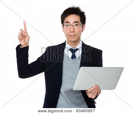 Businessman hold with laptop computer and finger point up