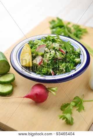 Tabbouleh - a bowl of fresh and green middle-eastern salad.
