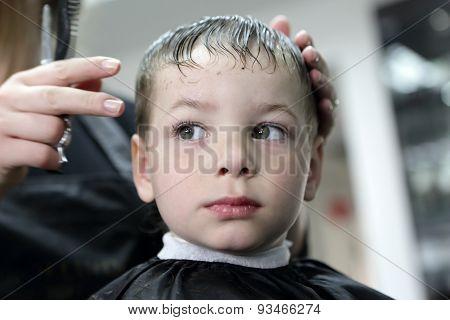 Serious Boy At Hairdresser Salon