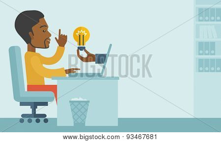 A black businessman sitting while working infront of his desk getting a brilliant idea for business from the laptop. Business concept. A contemporary style with pastel palette soft blue tinted