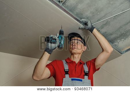 Worker Fixes The Drywall