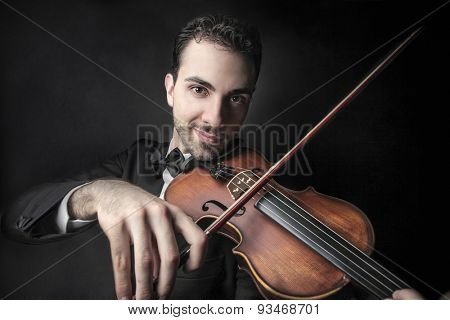 Violinist playing his instrument