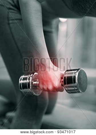 fitness, sport, sports injury, people and weightlifting concept - close up of young woman with dumbbells flexing muscles in gym