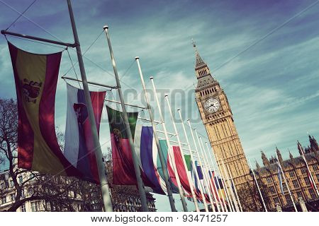Angled View of Row of International Flags in front of Iconic Big Ben Clock Tower, Palace of Westminster, London, England