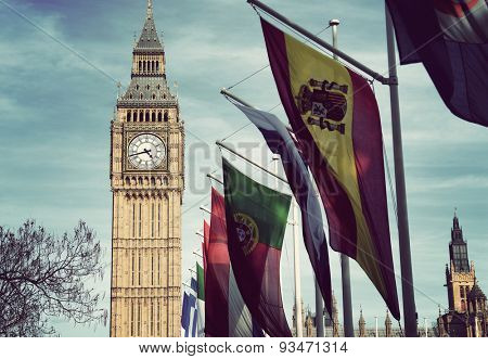 Row of International Flags in front of Iconic Big Ben Clock Tower, Palace of Westminster, London, England