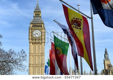Row of International flags in front of Big Ben, London, the iconic clock tower of the old Westminster palace at the Houses of Parliament