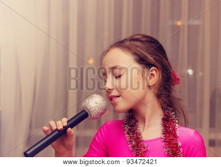 Toned portrait of Beautiful girl singing into a microphone