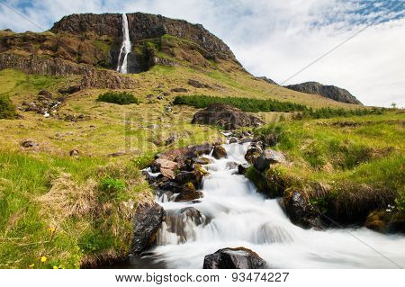 Beautiful small waterfall on Iceland and a brook. Snaefellsness peninsula