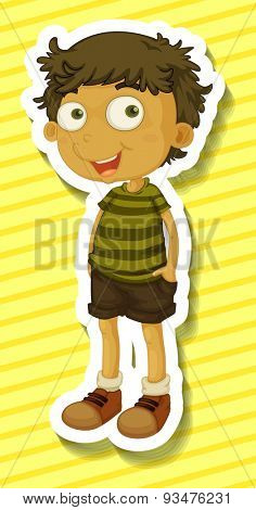 Happy boy standing alone on yellow background