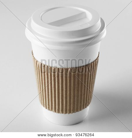 Paper cup of coffee isolated on white