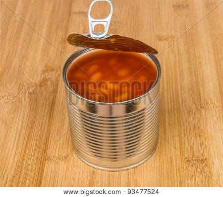 Open Metal Cans With Beans In Tomato Sauce On Board