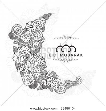 Muslim community festival, Eid Mubarak celebration greeting card with beautiful floral design on white background.