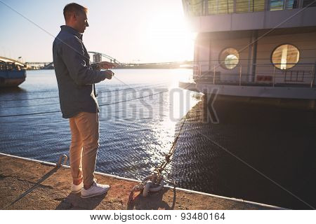 Man casting with light rod on the river