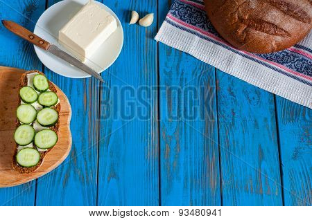 Freshly Baked Bread, Sandwich With Sliced Cucumbers And Butter On Dish In Rural Or Rustic Kitchen At
